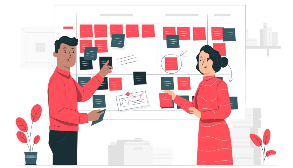 two people reviewing a scrum board