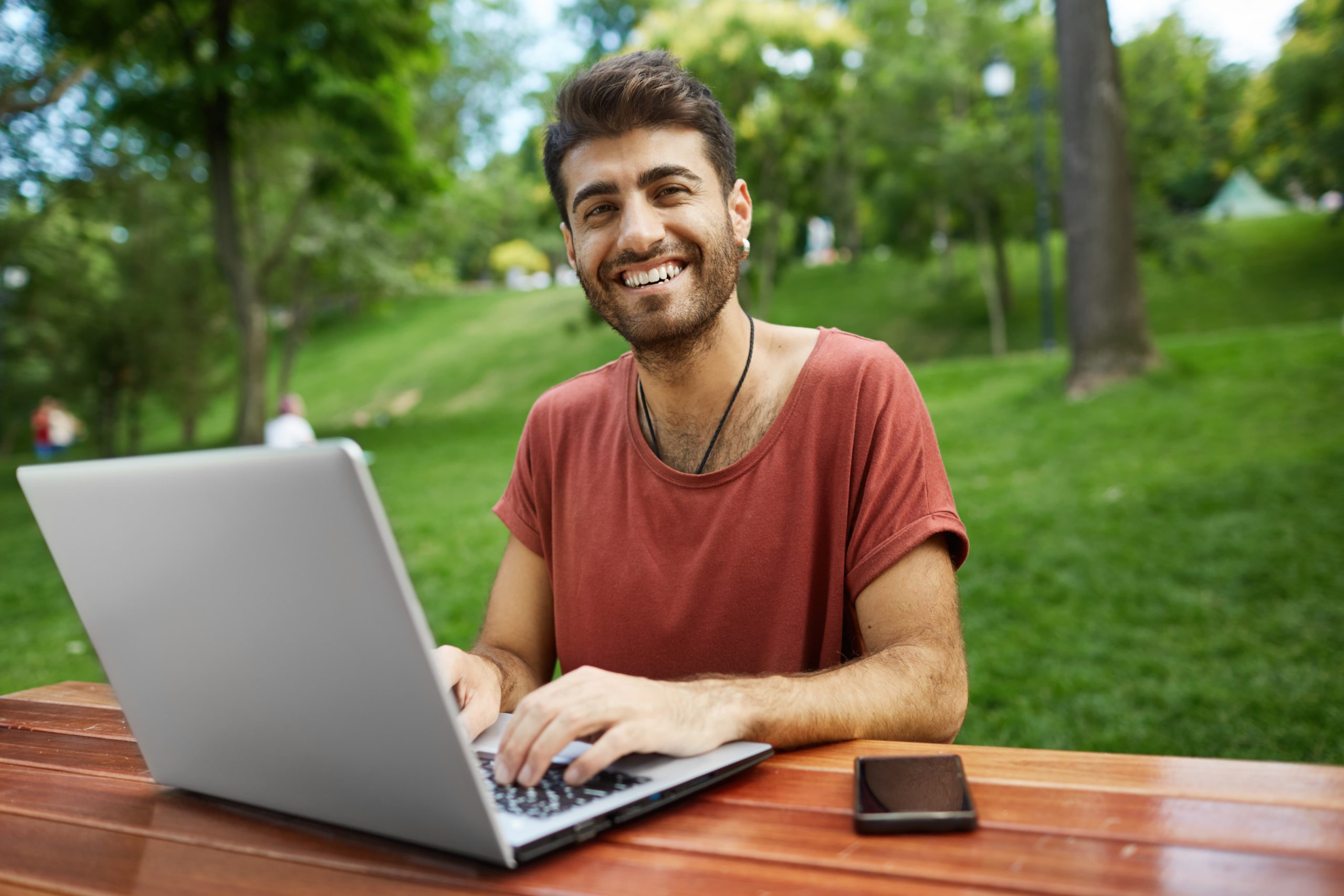remote-worker-freelancer-working-remote-sit-park-bench-with-laptop-connect-wifi
